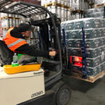 WDS Savannah uses state of the art warehouse management sottware. Here, an employee on Tow Motor is scanning a pallet label.